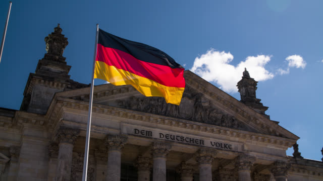 German Flag in front of Reichstag building, Berlin video