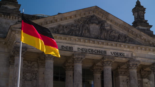 German National Flag in front of Reichstag in Berlin - Germany video