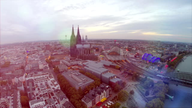 Germany from above, Cologne Koln aerial, city symbols Cathedral Dom, Rathaus and famous bridge. Cologne railway station and Opera, tourist attraction, sight seeing in German city, evening fly over video