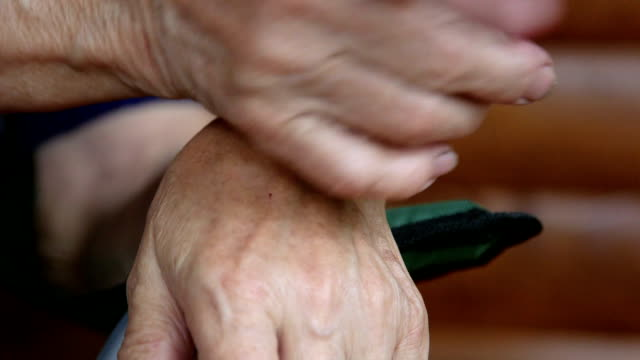 Gesticulating hands of senior woman during a conversation close-up video