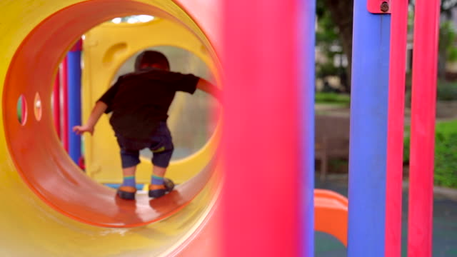 Get into the Tunnel Get into the Tunnel outdoor play equipment stock videos & royalty-free footage
