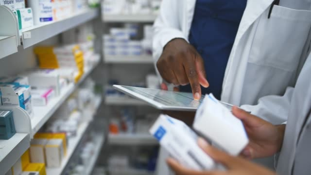 Get your digital script filled at your local pharmacy 4k footage of two pharmacist using a digital tablet while working in a apothecary pharmaceutical industry stock videos & royalty-free footage