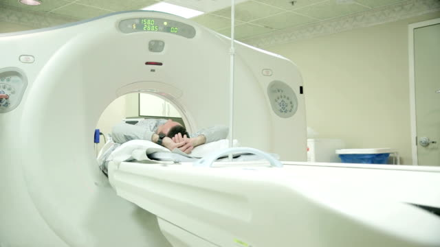 Getting an Examination HD footage of Man getting MRI Scan tomography stock videos & royalty-free footage