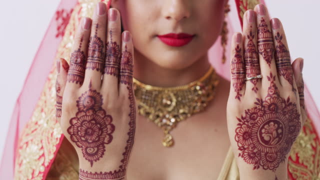 Getting decorative for her big day 4k video footage of an unrecognizable woman with mehendi painted on her hands on her wedding day indian culture stock videos & royalty-free footage