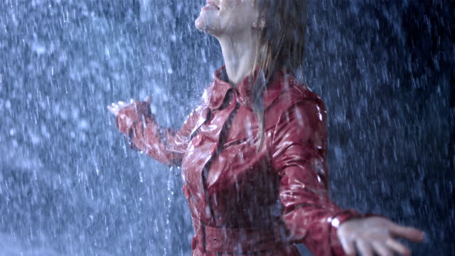Getting Drenched In The Heavy Rain HD1080p: Woman enjoying the heavy rain while she looking up to the sky with her arms outstretched. drenched stock videos & royalty-free footage