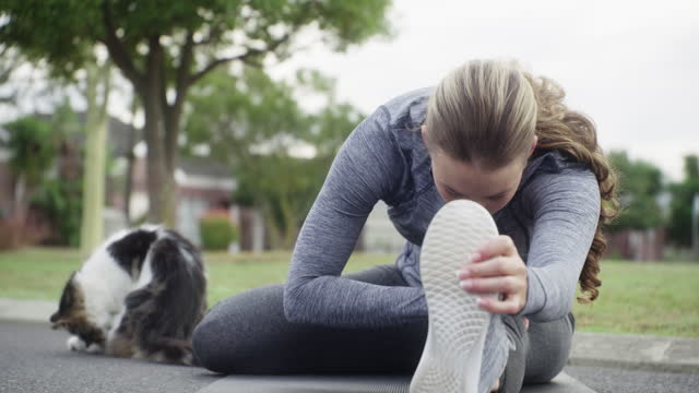 Getting fit with her feline friend