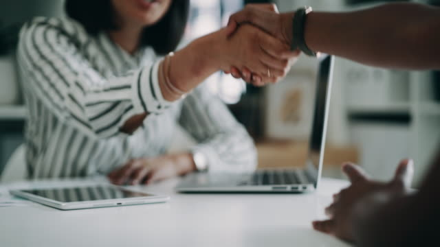 Getting the formalities out of the way 4k video footage of two unrecognizable business colleagues shaking hands during an interview in the office business handshake stock videos & royalty-free footage