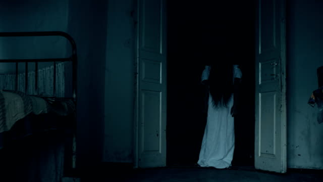 Ghost Standing In the Doorway Ghost standing in the doorway. Spirit Of The Girl In An Old Scary House ghost stock videos & royalty-free footage