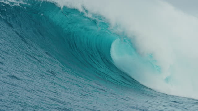 Giant Blue Ocean Wave Breaking in Slow Motion Giant blue ocean wave breaking dramatically in slow motion giant fictional character stock videos & royalty-free footage