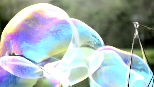 Giant Bubbles Giant soap bubbles in the park. Shot with a Nikon D800 camera. giant fictional character stock videos & royalty-free footage