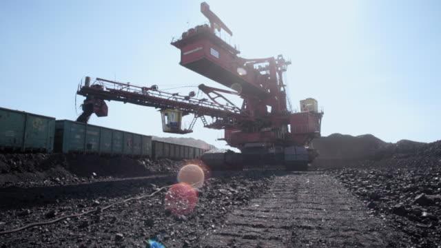 giant bucket wheel excavator for open pit coal mine - lignite - уголь стоковые видео и кадры b-roll
