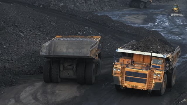 Giant dump trucks at the coal mining