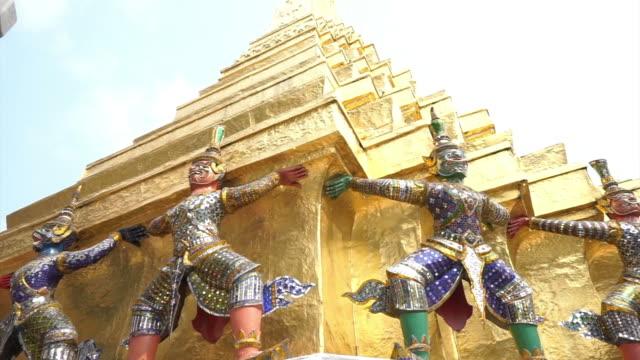 Giant guards angel at Wat Phra Kaew, Temple of the Emerald Buddha Landmark of Bangkok,Thailand video