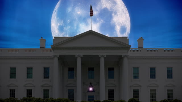 A giant moon with flickering stars over The White House in Washington, D.C. USA