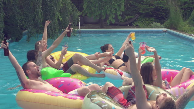 Giant Soap Bubbles Young Adult Pool Party outdoor Summer BBQ Young adult making giant soap bubbles pool party outdoor summer BBQ pool party stock videos & royalty-free footage