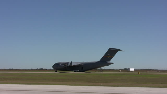 Giant transport airplane Modern US Air Force cargo jet taxiing after landing us military stock videos & royalty-free footage