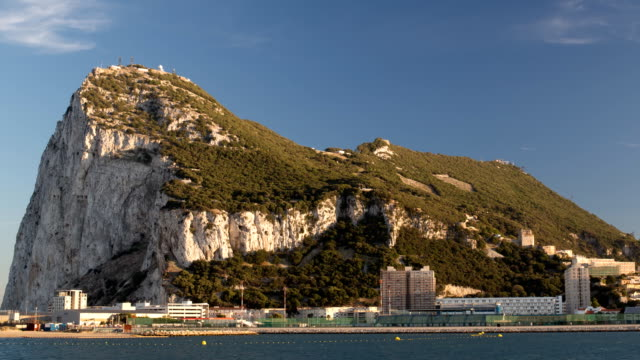 gibraltar time lapse of the rock of gibraltar, a british territory next to spain uk border stock videos & royalty-free footage