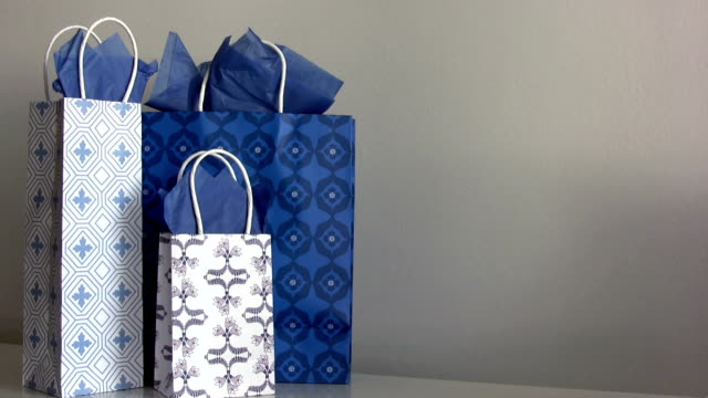 Gift bags Gift bags. HD 1080i. gold card stock videos & royalty-free footage