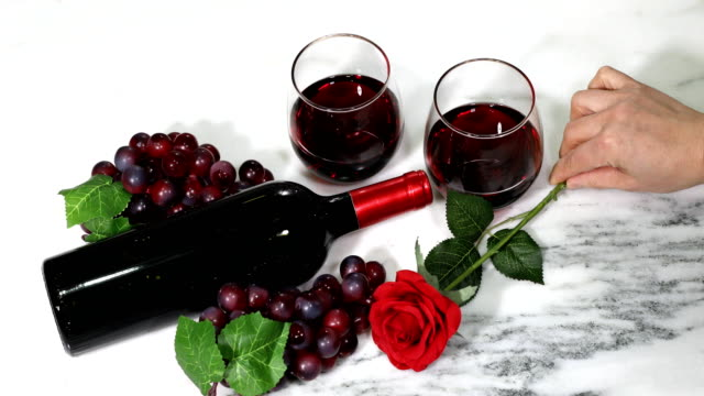 Gift box and rose with red wine video