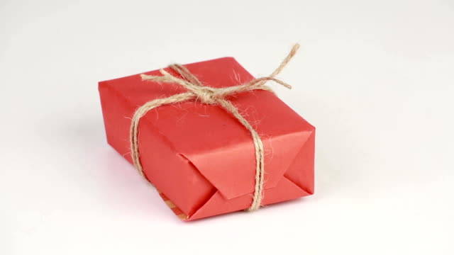 Gift box covered with red wrapping paper video