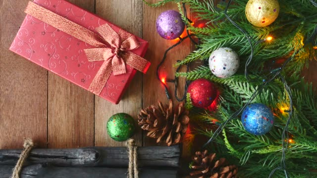 Gift box with Christmas decoration on wooden table video