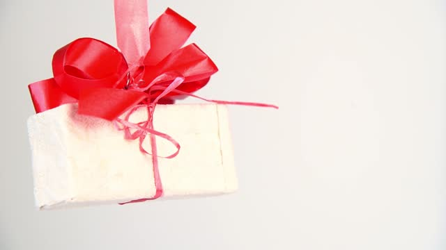 gift box with text 2022 rotating on white background, new year card, selective focus