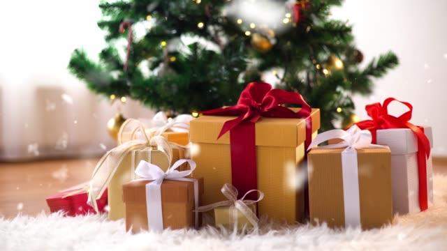 gift boxes on sheepskin near christmas tree