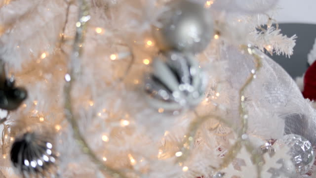 Gift on white christmas tree video