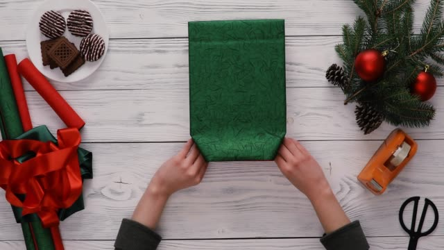 Gift Wrapping Top View Woman Wrapping Christmas Present On The White Rustic Table. Hands Only, Directly Above pine nut stock videos & royalty-free footage