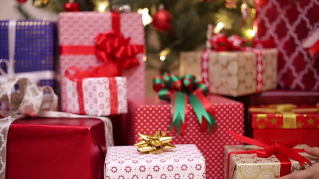 Gifts stack for Christmas day Gifts stack for Christmas day with 4K video. holiday stock videos & royalty-free footage