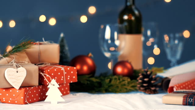 gifts, wine, glasses and beautiful New Year's decoration video