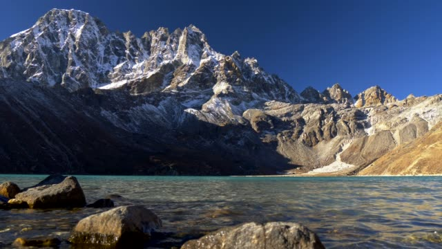 Gimbal shot of the Gokyo Lake and Himalayan snowy rocks in Nepal. Three pass trek. 4K, UHD