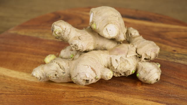 Ginger sprouts Ginger sprouts on a rotating wooden plate ginger spice stock videos & royalty-free footage