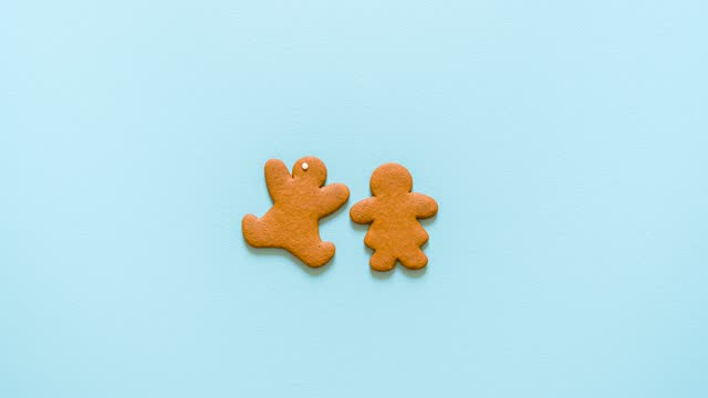 Gingerbread cookies baking process, stop motion. Gingerbread man video recipe Making gingerbread cookies step by step on green background stop motion. Baking Christmas cookies, video recipe. Homemade gingerbread man recipe. gingerbread man stock videos & royalty-free footage