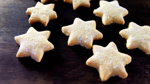 Gingerbread cookies with powdered sugar sprinkled on top 4k video