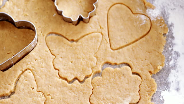 Gingerbread dough with flour and cookie cutter 4k video