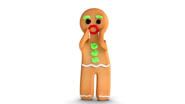 gingerbread man is cheering - pepparkaka bildbanksvideor och videomaterial från bakom kulisserna