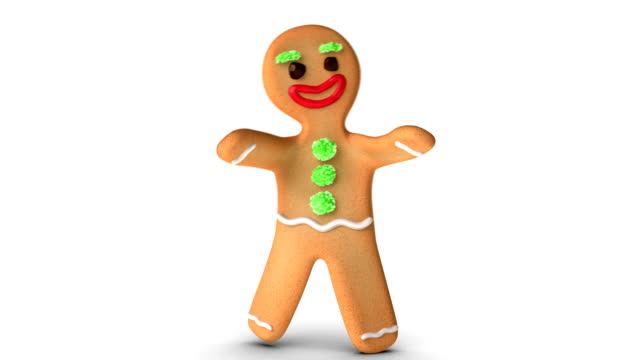 Gingerbread Man is Learning To Walk Gingerbread man is learning to walk against white background. Alpha Channel added. gingerbread man stock videos & royalty-free footage