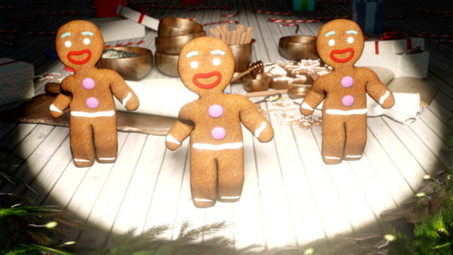 vídeos de stock e filmes b-roll de gingerbread men dancing in the middle of a festive christmas table. the concept of the celebration. looped animation. - christmas cooking