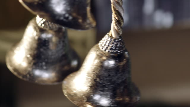 Gingle bells ringing Small silver bells ringing with Christmas tree background silver metal stock videos & royalty-free footage