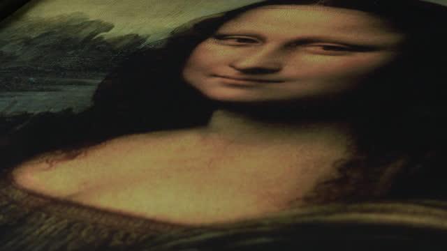 Gioconda o Mona Lisa picture rotating Gioconda o Mona Lisa picture rotating renaissance architecture stock videos & royalty-free footage