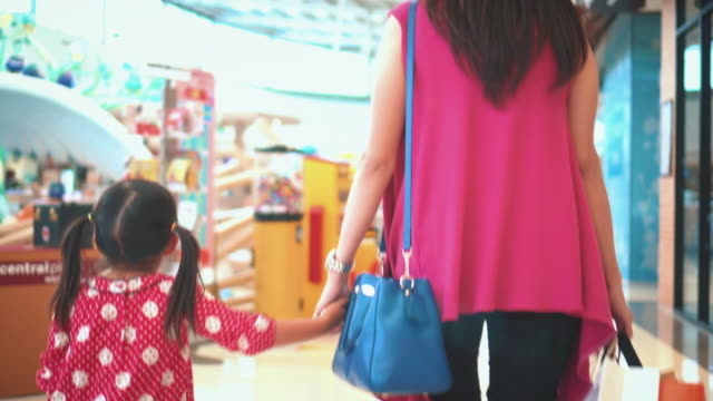 Girl and Mother Carrying Bags In Shopping Mall,Steadicam shot video