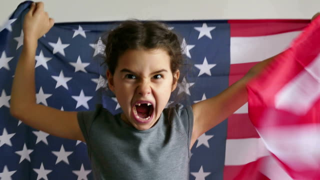 Girl and USA American Flag girl  shouting teen holding usa American flag Independence Day circa 4th century stock videos & royalty-free footage
