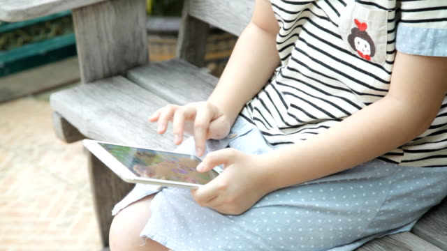 Girl are using on digital tablet at home video