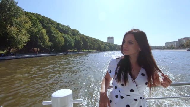 Girl at the stern on river