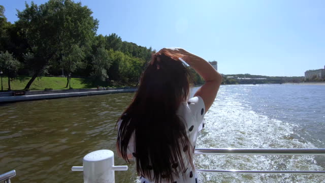 Girl at the stern on river video