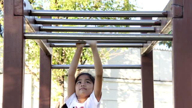girl balances body on bar video