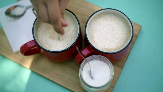 Girl batters in a red coffee cup video