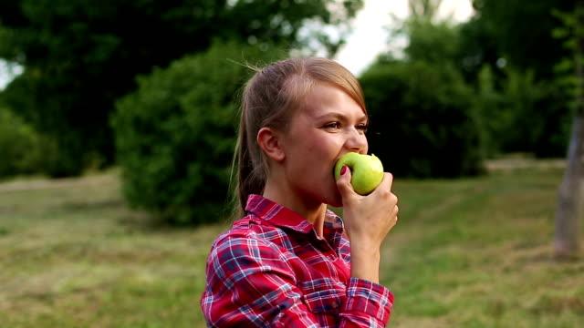 Girl biting an apple video