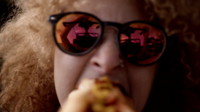 Girl Biting Into Hotdog Girl biting into hotdog close to camera hot dog stock videos & royalty-free footage